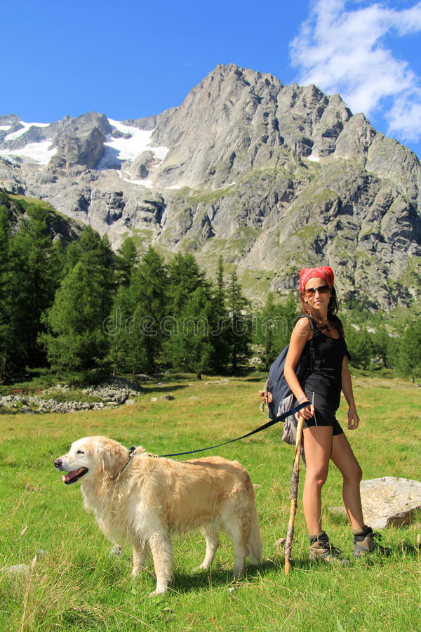 Download Hiking girl with her dog stock image. Image of adventure - 26480205