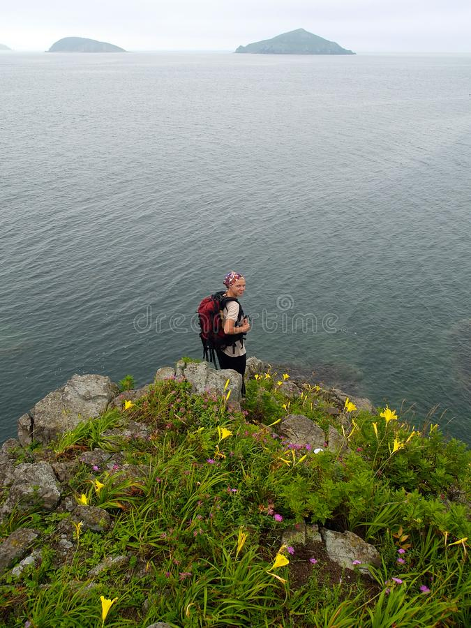 hiking girl on the ocean rock stock photos