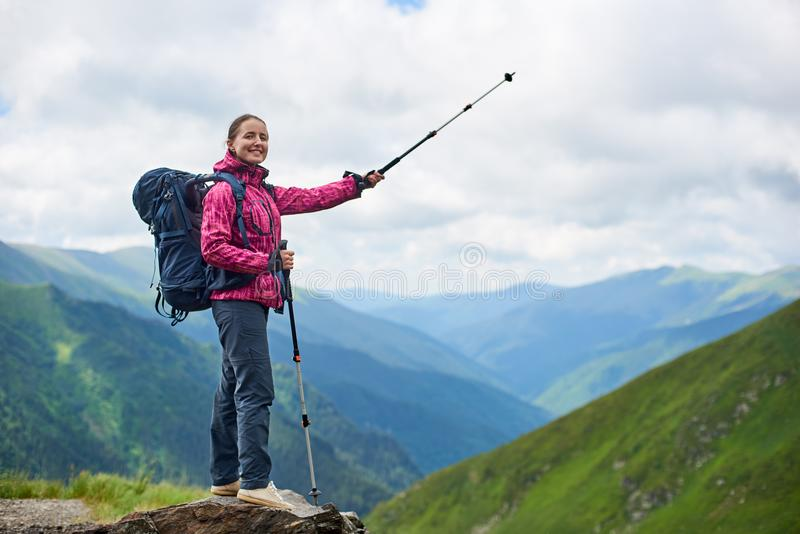 Hiking girl stands on rock against mighty mountains Romania stock images