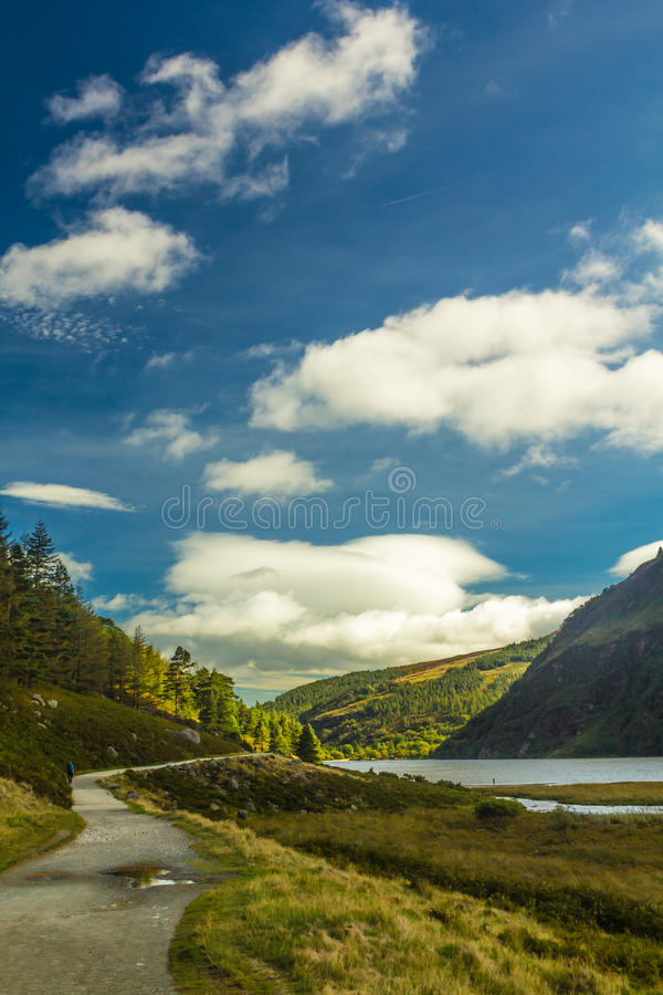 Download Hiking Through Glendalough Upper Lake On A Sunny Day, County Wicklow, Ireland Stock Image - Image of valley, mountains: 35584409
