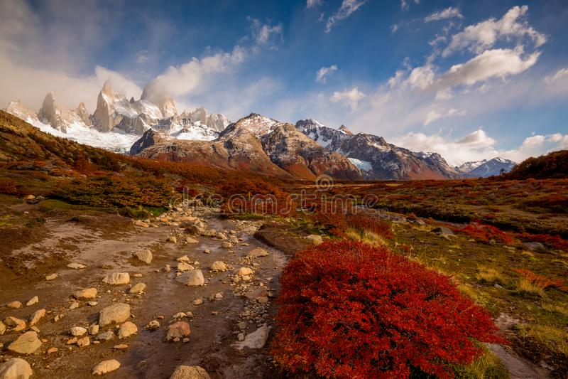 Snow-covered Mount Fitz Roy on beautiful fall day. Hiking in Los Glaciares National Park on a beautiful fall day, taking in the autumn colors in their full glory stock image