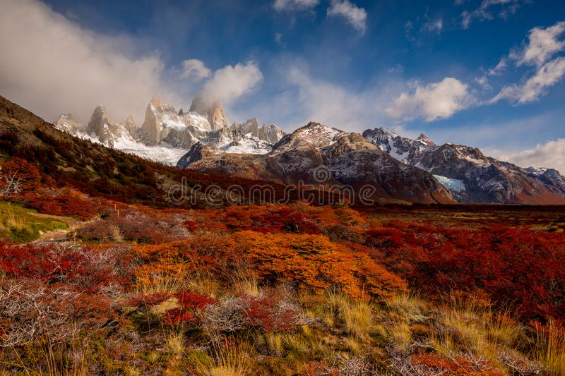 Snow-covered Mount Fitz Roy on beautiful fall day. Hiking in Los Glaciares National Park on a beautiful fall day, taking in the autumn colors in their full glory stock photography