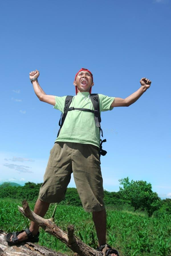 Hiking man celebration stock image