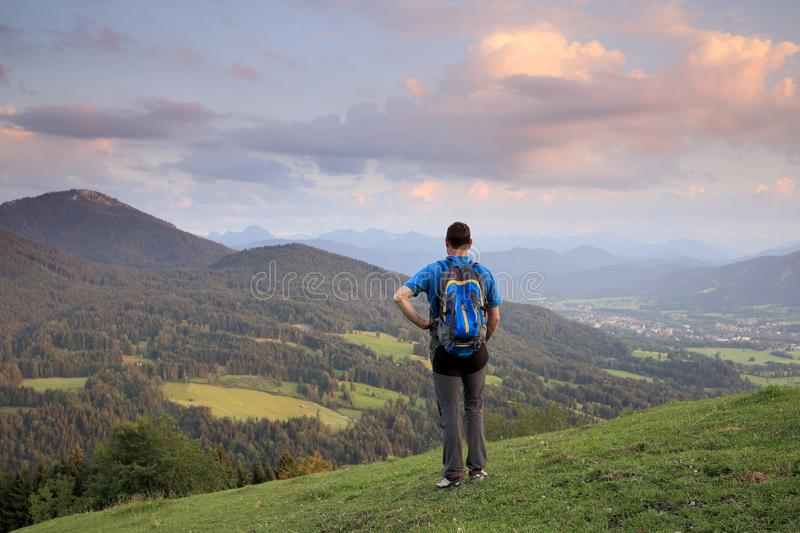 Hiker and landscape. Hiking man is looking to the sundown royalty free stock photography