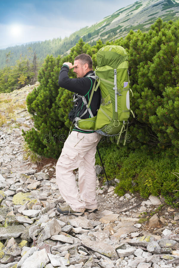 Hiking man portrait with backpack stock images