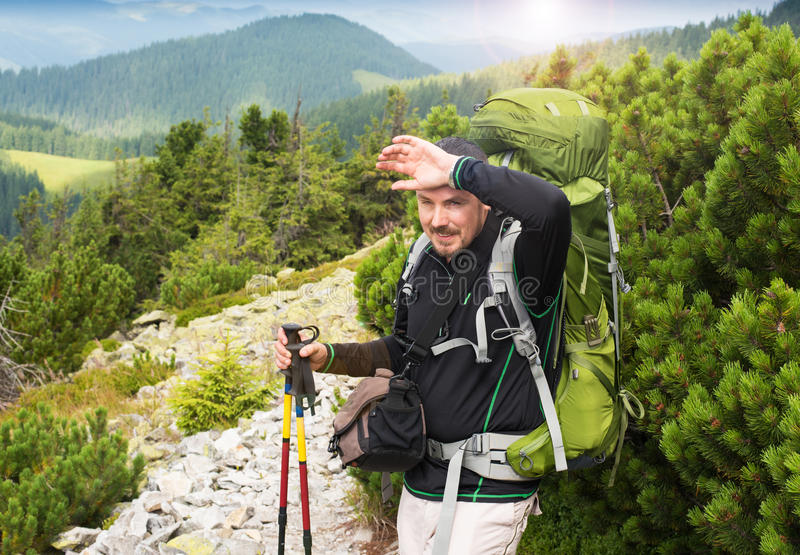 Hiking man portrait with backpack stock photo