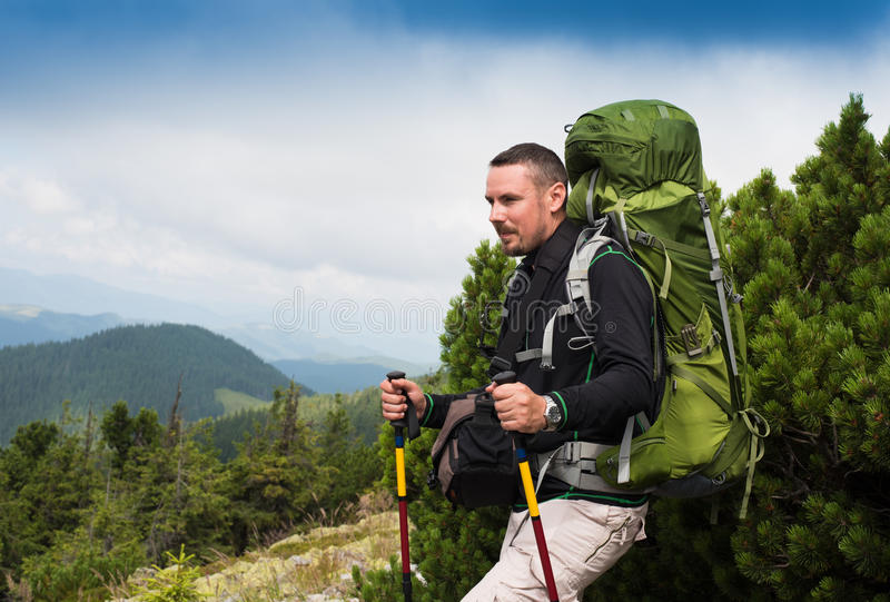 Hiking man portrait with backpack royalty free stock image