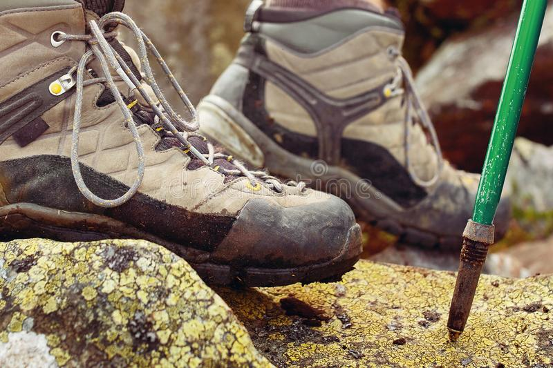 Hiking man with trekking boots on the trail. Closeup of male feet on hiking. Active life concept royalty free stock photos