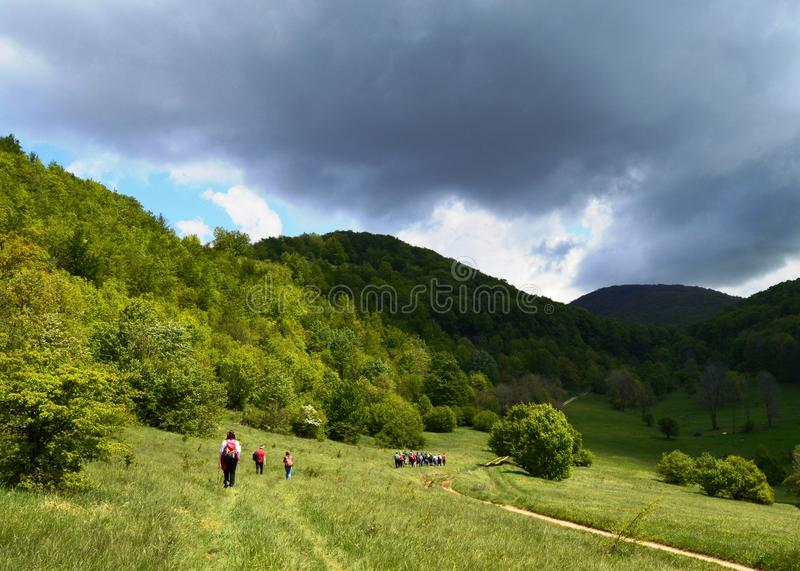 Hiking on the monuntains. Storm is coming while hiking on the green mountains royalty free stock photos