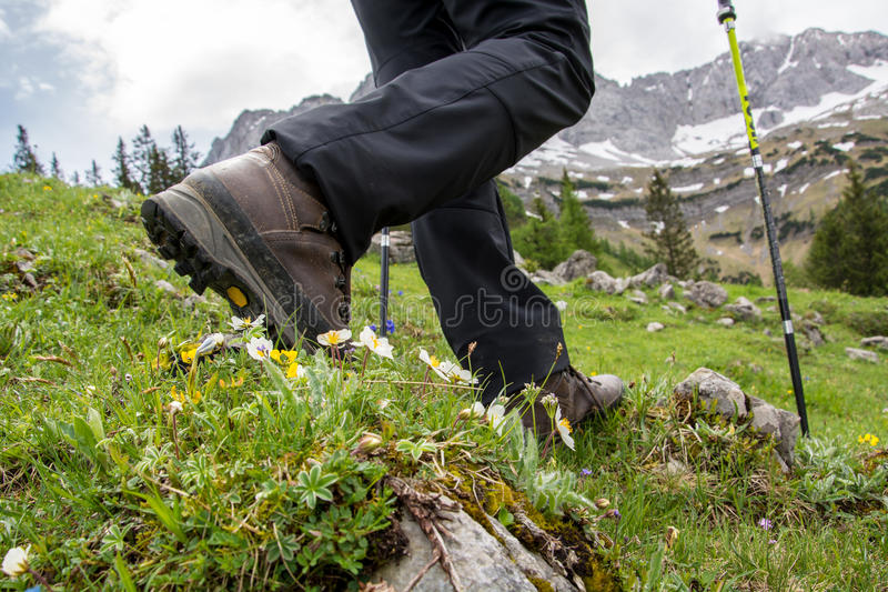 Hiking in the mountains with hiking boots royalty free stock image