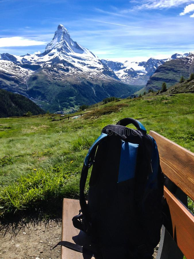 Hiking Natural Trail with view of Matterhorn Peak in summer, Zermatt, Switzerland, Europe. Family Activities, Hiking in the wild. Rest and Refresh on wooden stock photo