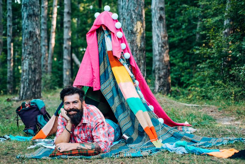 Hiking and outdoor recreation concept with flat camping travel. Hovel decorated party. Homemade Tent Camping for free stock photo