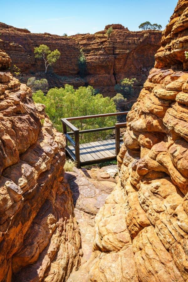Hiking over the bridge in kings canyon, watarrka national park, northern territory, australia 3. Hiking the bridge in kings canyon on a sunny day, watarrka stock image