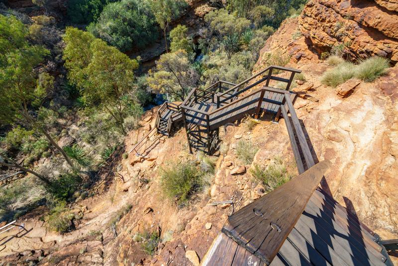 Hiking over the bridge in kings canyon, watarrka national park, northern territory, australia 8. Hiking the bridge in kings canyon on a sunny day, watarrka royalty free stock images