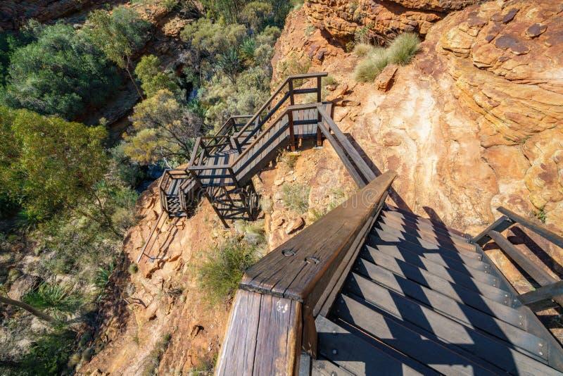 Hiking over the bridge in kings canyon, watarrka national park, northern territory, australia 10. Hiking the bridge in kings canyon on a sunny day, watarrka stock photos