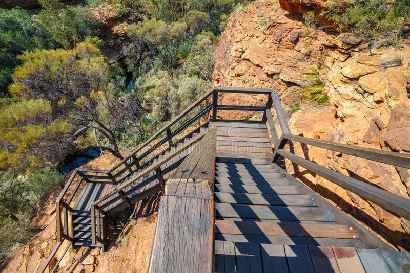 Hiking over the bridge in kings canyon, watarrka national park, northern territory, australia 13. Hiking the bridge in kings canyon on a sunny day, watarrka stock images