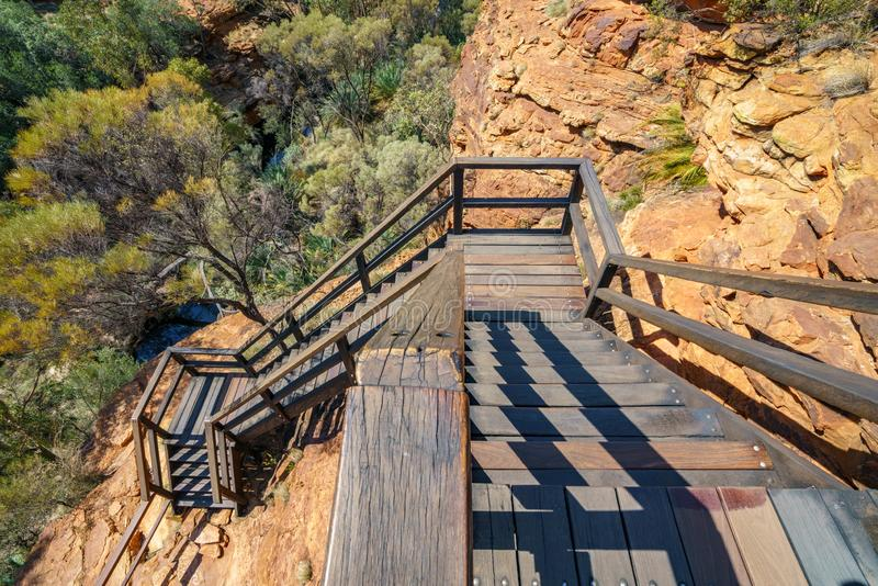 Hiking over the bridge in kings canyon, watarrka national park, northern territory, australia 14. Hiking the bridge in kings canyon on a sunny day, watarrka royalty free stock photography
