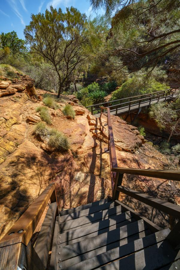 Hiking over the bridge in kings canyon, watarrka national park, northern territory, australia 16. Hiking the bridge in kings canyon on a sunny day, watarrka stock photography