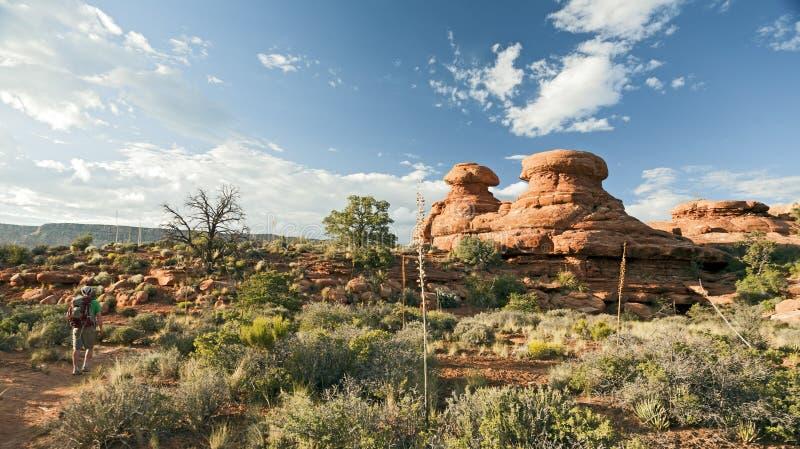 Hiking Past Dramatic Rocks stock image