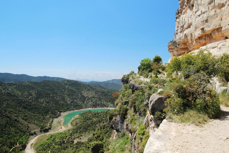 A hiking path in a terrain of Siurana, Spain. Siurana is a village of the municipality of the Cornudella de Montsant in the comarca of Priorat, Tarragona stock image