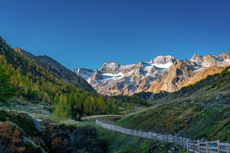 Hiking path at Timmelsjoch and Texelgruppe nature park leading to the Seebersee with the alpine mountains in the background royalty free stock photography