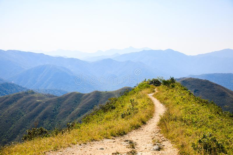 Hiking path to a mountain peak, Hong Kong stock images