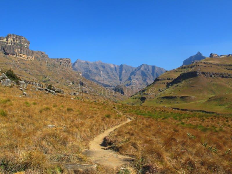Hiking Path to Rhino Peak, uKhahlamba Drakensberg National Park. Hiking Path to Rhino Peak at Garden Castle Reserve of uKhahlamba Drakensberg National Park stock photo