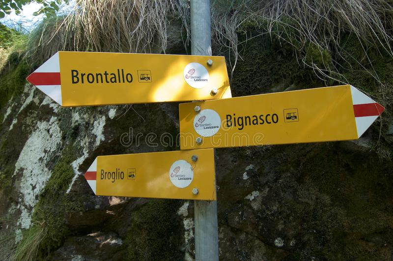 Hiking pathway sign in the famous Ticino Canton in Switzerland. Some hiking pathway sign captured in the village of Bignasco in the beautiful Maggia Valley in royalty free stock images