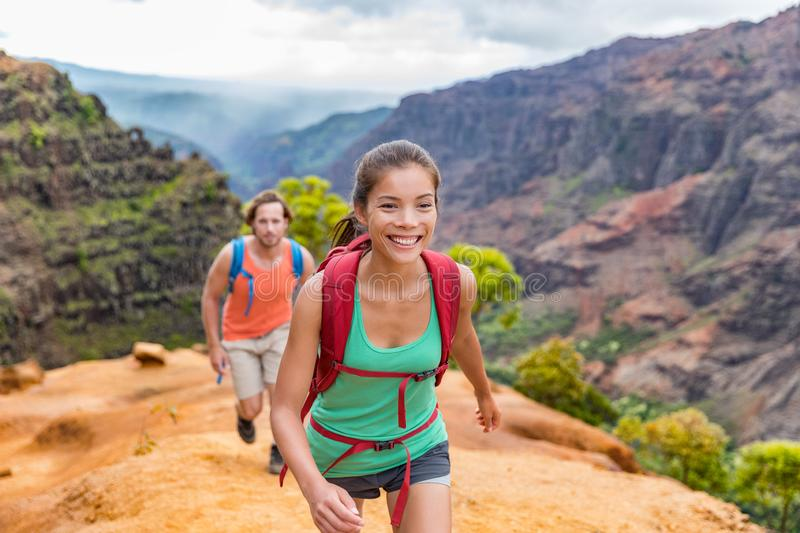 Hiking people on Hawaii Waimea Canyon Trail, Kauai island, USA. Young woman and man hikers walking in mountain nature landscape in. Hiking people on Hawaii stock photos
