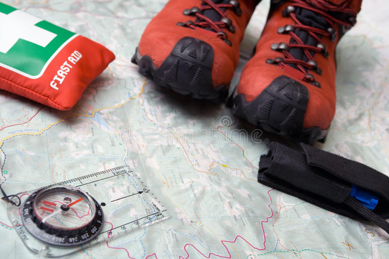 Hiking shoes and equipment on map stock photo