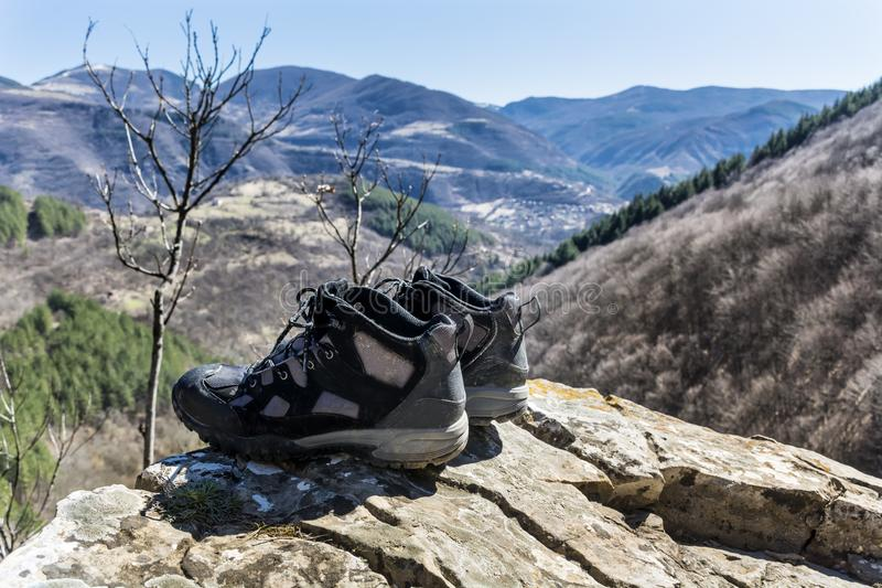 Hiking Shoes on a Mountains Landscape Background royalty free stock photo