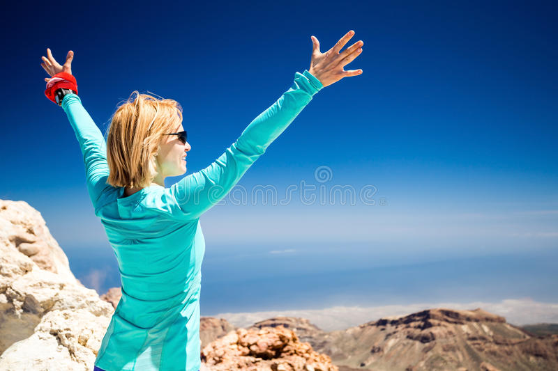 Hiking success, woman on trail in mountains royalty free stock image