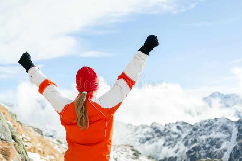 Hiking success, woman in winter mountains stock images