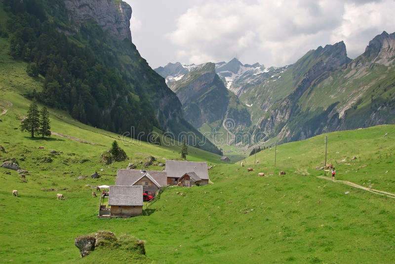 Hiking In Swiss Alps Stock Photo