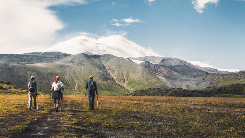 Hiking Team Goes To Mount Elbrus, Rear View. Travel Destination Experience Lifestyle Concept concept royalty free stock images