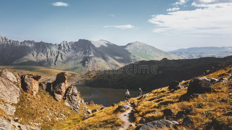 Hiking Team Goes To Mount. Travel Destination Experience Lifestyle Concept concept. Group Of Hikers Man And Womans With Trekking Poles Walking Along In Summer stock image