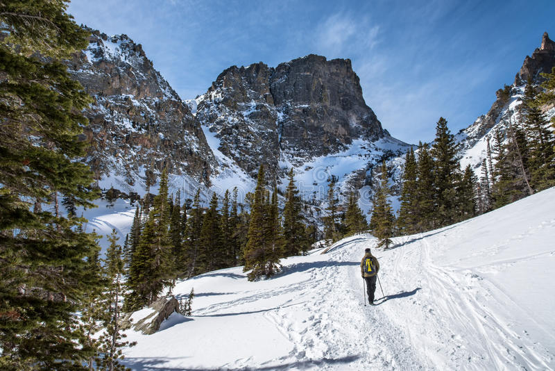 Hiking to Emerald Lake in Winter. Hiking the Dream Lake trail in Rocky Mountain National Park begins at Bear Lake and continues on to Nymph Lake, Dream Lake, and stock photo