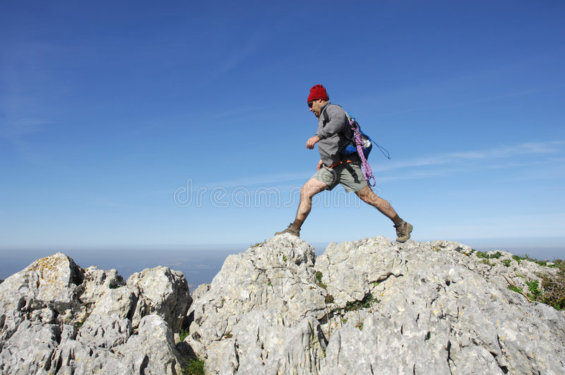Hiking on the top of a mountain stock photography