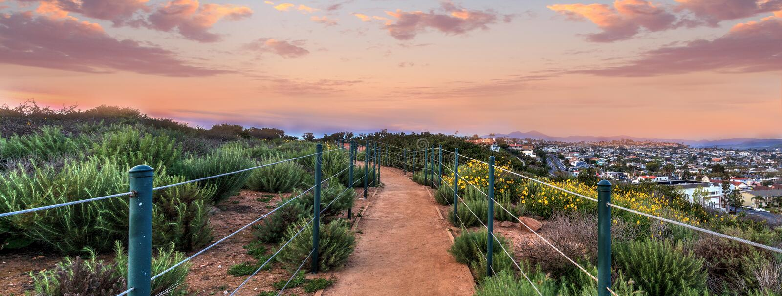 Hiking trail above Dana Point city view at sunset royalty free stock images