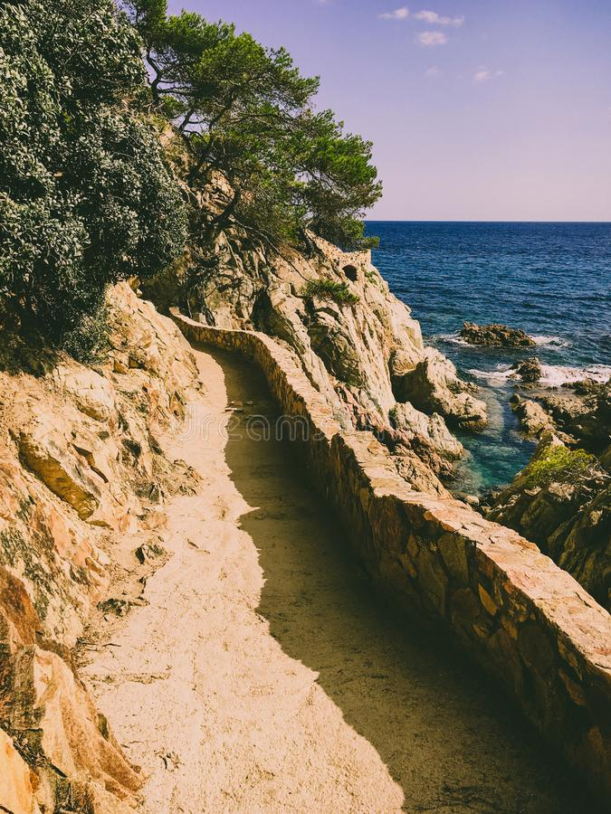 A hiking trail along the cliffs for tourists on Costa Brava of the Mediterranean Sea in Spain near Lloret de Mar stock photos