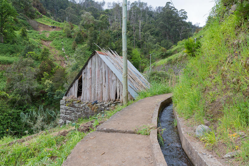 Hiking trail along an irrigation levada at Madeira stock photography