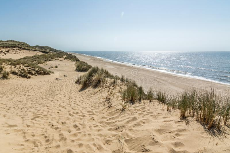 Hiking trail in beautiful dune landscape with beach and ocean in the background on the island of Sylt, Germany stock photos