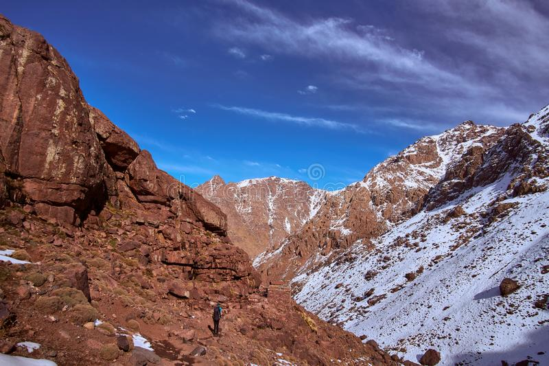 Hiking trail down to Imlil from Jebel Toubkal mountain stock images
