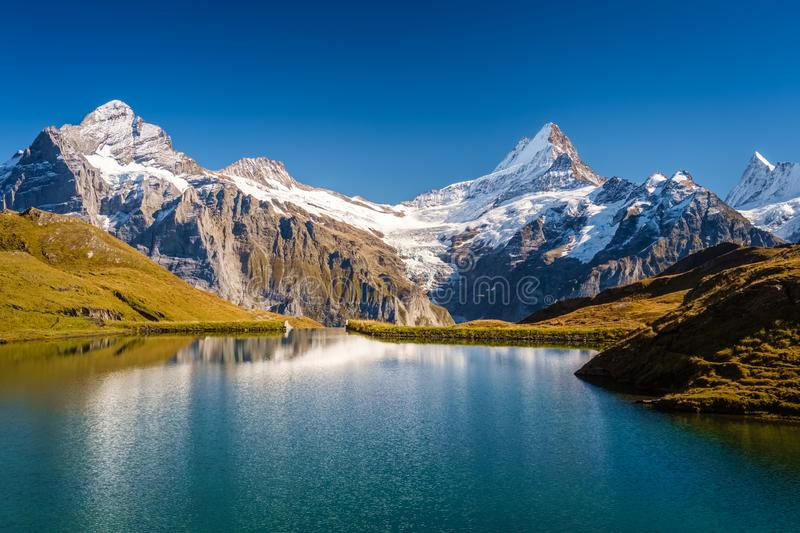 Encountering Bachalpsee when hiking First to Grindelwald Bernese Alps, Switzerland. The hiking trail from First to Grindelwald along the Bachalpsee is very royalty free stock photos