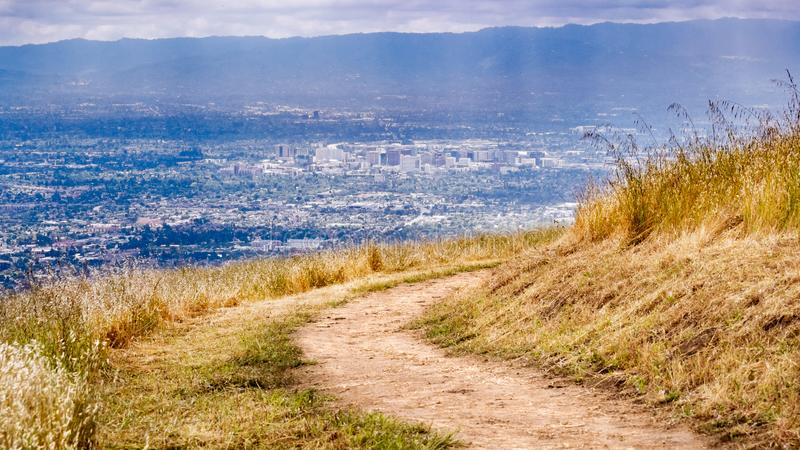 Hiking trail on the hills of South San Francisco bay area, aerial view of downtown San Jose visible in the background; California stock photography