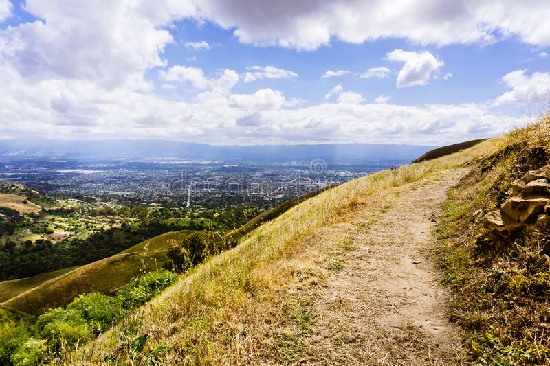 Hiking trail through the hills of south San Francisco bay area, San Jose visible in the background, California stock images