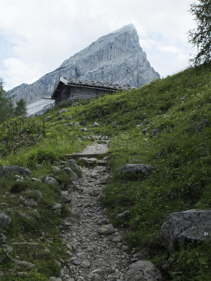 Hiking trail. And hut in the alps stock photography