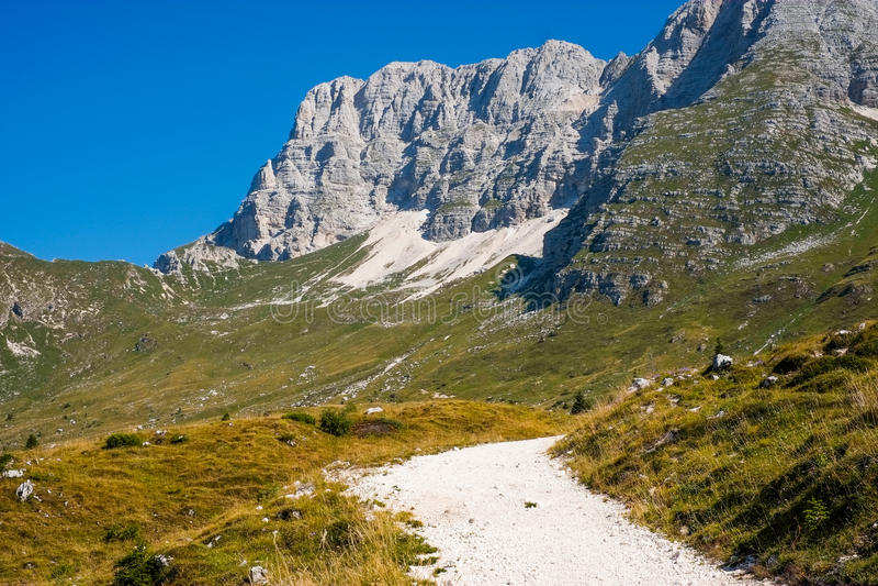 Hiking trail on the mountains. Hiking trail on altopiano di Montasio, Sella Nevea, Italy stock image