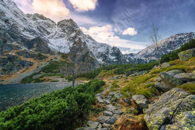 A hiking trail near the high mountain lake. stock images