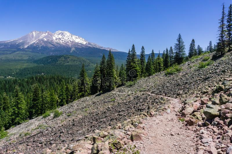 Hiking trail in Siskiyou County; Shasta mountain covered in snow visible in the background; Northern California royalty free stock photo